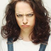 picture of frown  - Portrait of dissatisfied young woman - JPG
