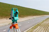 image of theodolite  - Working with a modern theodolite or total station on a tripod - JPG