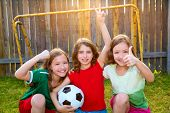 image of three sisters  - three sister girls friends soccer football winner players on the backyard - JPG