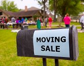 stock photo of yard sale  - Moving sale in an american weekend on the yard green lawn - JPG