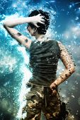 pic of camouflage  - Artistic grunge effect portrait of a Young female hero fighting and holding a gun and wearing camouflage clothes - JPG