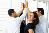 stock photo of team  - Business Team Giving One Another High Five - JPG