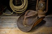 pic of lasso  - an image of a cowboy hat laying on the barn floor - JPG
