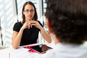 stock photo of candid  - Businesswoman Interviewing Male Candidate For Job - JPG