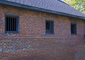 image of blacksmith shop  - Barred windows on the back of a South Carolina Blacksmith shop built in the early 1800 - JPG