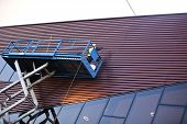 picture of girder  - Builder on a Scissor Lift Platform on a construction site - JPG