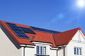 picture of roof-light  - Alternative energy photovoltaic solar panels on tiled house roof - JPG
