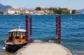 image of lagos  - Small boat in front of Isola Bella the most beautiful of the three Isles of Lago Maggiore Italy - JPG