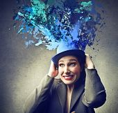 stock photo of sorcerer  - young magician with funny blue hat - JPG
