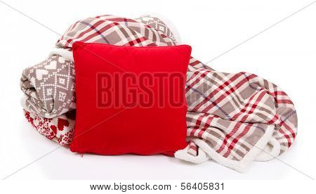 Warm plaids and pillow isolated on white