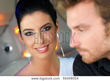 Beautiful elegant woman looking at camera, smiling.
