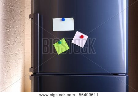 Empty paper sheets on fridge door