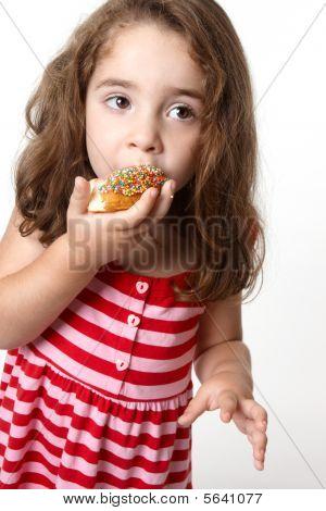 Pretty Little Girl Eating A Doughnut