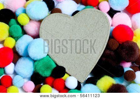 Miuticolored pom-poms with paper heart