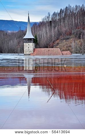 Abandoned Church In The Middle Of A Lake Full With Mining Residuals
