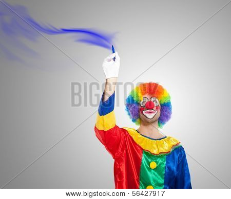 Colorful clown draing on the screen