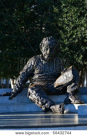 WASHINGTON, D.C., DECEMBER 28, 2013: Albert Einstein Memorial - bronze statue by Robert Berks on the grounds of the National Academy of Sciences. The Statue is a tourist magnet in National Mall.