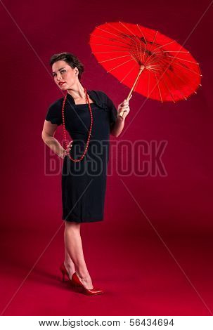 Pinup Girl In Black Dress With Red Parasol