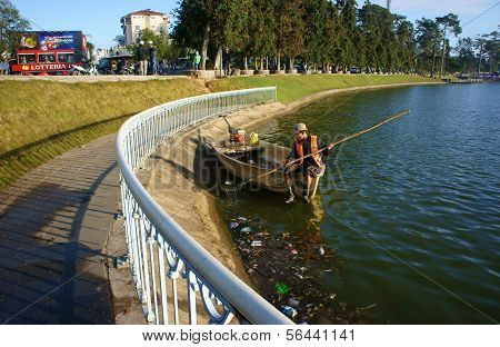 Vietnamese Sanitation Worker Pick Up Rubbish From Lake