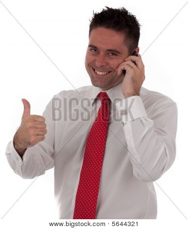 Successful Young Businessmen Talking On The Phone Giving The Thumbs Up