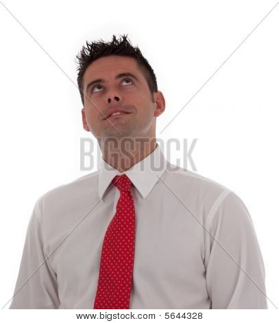 A Young Businessman Looks To The Sky With Regret