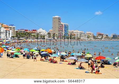 PENISCOLA, SPAIN - JULY, 26: Bathers in North Beach on July 26, 2013 in Peniscola, Spain. The town is a typical summer destination facing the Mediterranean Sea, in the North of the Valencian Community