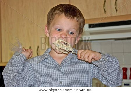 Boy Licking Off Mixer Beater