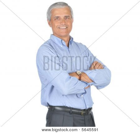 Smiling Middle Aged Businessman With Arms Crossed