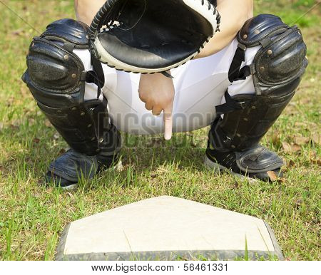 Baseball Catcher Showing Gesture For Secret Sign