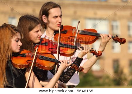 Trio Of Violinists Plays Outdoor