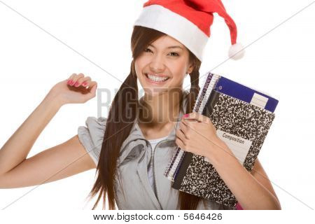 Asian Student Girl In Christmas Santa Hat With Composition Book
