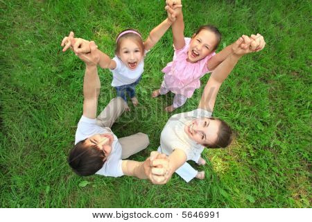 Family Stand Having Joined Hands And Having lifted them