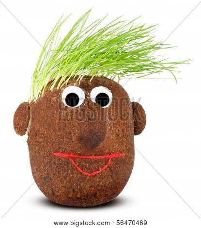 Puppet With Ground Wheat Sprouts For Hair.