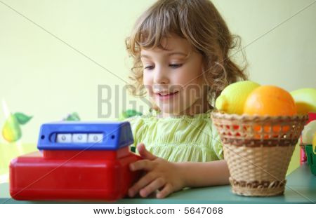 Little Girl Plays Shop