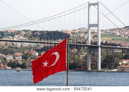 Turkish Flag And The Bosphorus Bridge In Istanbul