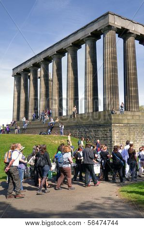 EDINBURGH - MAY 29: Tourists at the National Monument on the Calton Hill May 29, 2009 in Edinburgh, Scotland