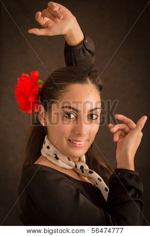 Portrait of beautiful woman with flower dancing