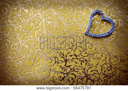 Elegant Heart-shaped Jewelry In Gold-colored Background.