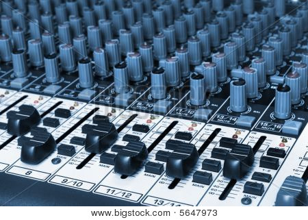 Closeup Of An Audio Mixing Board