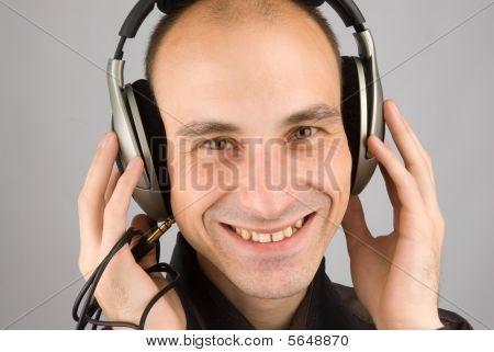 Man Listening Music In Headphones