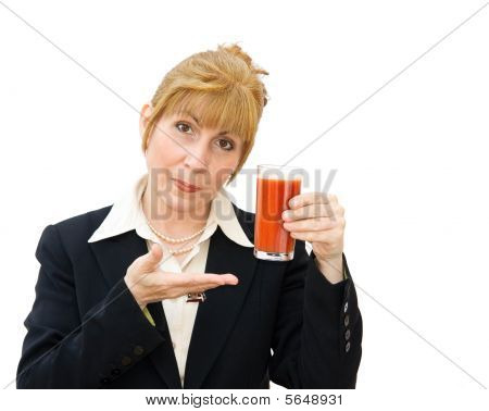 Woman with glass of tomato juice