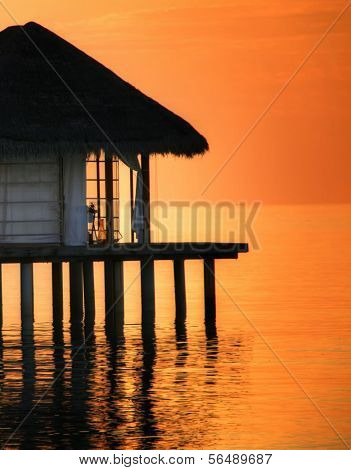 Pavilion on water in dusk, Maldive Islands