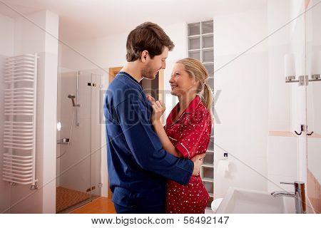 Couple Standing In Bathroom
