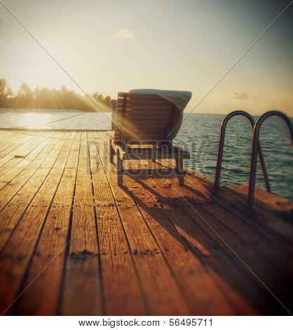 Beach chair in dusk on Maldives