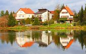 stock photo of suburban city  - The Litice Village houses on the bank Czech Valley Reservoir - JPG