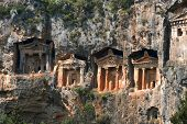 stock photo of dalyan  - There are four necropoli of Lycian rock-cut tombs in the form of temple fronts carved into the vertical faces of cliffs in the Dalyan river valley Turkey.