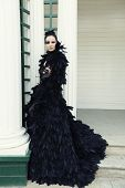 stock photo of evil queen  - Fashion model in black dress - JPG
