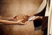 stock photo of jesus  - Jesus gives bread and fish on beige background - JPG