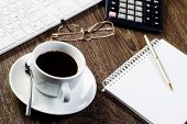 stock photo of numbers counting  - Business work place with cup of coffee calculator and glasses - JPG