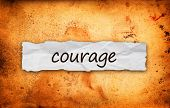 picture of daring  - Courage title on piece of crumpled old paper - JPG